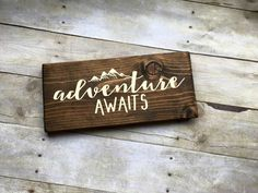 Description  Introducing Mini Signs!  Approximately 5x 12x1 Hand crafted adorable Adventure Awaits sign. This is the perfect addition to any traveler, explorer or adventurists collection! Simple and sweet! Can be hung on the wall or displayed on a shelf.   Each sign is stained with dark walnut, hand painted and then sealed. Since each sign is hand crafted no two will be exactly alike which is the beauty of handmade. Your sign will arrive ready to hang on the wall with a saw tooth hanger…