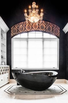 Stunning Master Bathroom accented with custom window treatments