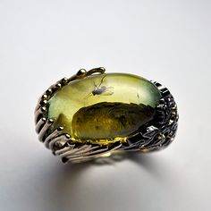 A different view of the unique ring of gold, green amber and black diamonds by GatoJewel-DerKater.
