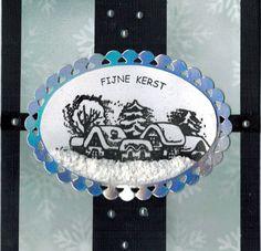 Een besneeuwd dorpje met de Snowy Village stempel van Nellie Snellen. Met sneeuwpasta en glitterlijm maak je de kaart nog mooier. Verkrijgbaar bij www.multihobby.nl