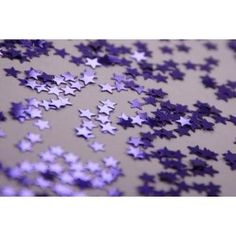 Shiny purple stars for scattering over the table.