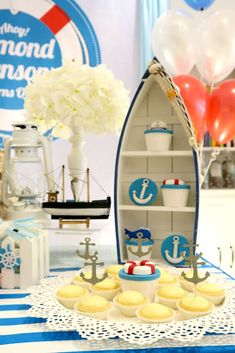 Check out the cool cupcakes and sweet treats at this Nautical 1st birthday party! See more party ideas and share yours at CatchMyParty.com #1stbirthday #nautical #cupcakes