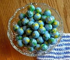 Chocolate balls wrapped in globe decorated foil.
