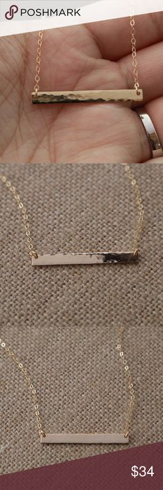 """14K Gold-Filled Textured Necklace - Handmade! Skinny & dainty 14K Gold-Filled bar necklace- versatile with its beautiful textured detailing! Perfect to wear alone or stacked with other necklaces.  DETAILS • 14K Gold-Filled Hand-Hammered Bar 35x3.2mm • Bar suspends from dainty, sparkly&strong cable chain with lobster clasp closure • All components: 14K Gold-Filled • Necklace length: 18"""" (if you want a different length LMK)  This necklace is exclusively handcrafted for you! No one will have…"""