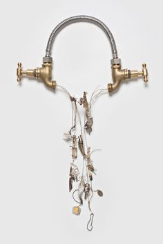 "Inari Kiuru- ""Wedding ornaments for another time 1: Drought"" ( 2008)  shower cable, brass taps, 925 silver, 18ct gold, found objects  fused, soldered, fabricated"