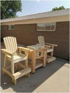 rustic yet comfy adirondack chairs are pieces of patio furniture in rh pinterest com