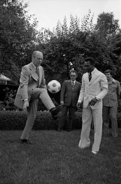 President Gerald Ford and Brazilian footballer Pelé kicking a ball around the White House lawn in their snazzy 1975 suits.