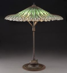 """Tiffany """"Lotus"""" leaded glass lamp with bronze"""