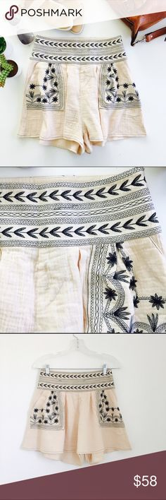 Bohemian Traders shorts Embroidered Moonflower shorts by Bohemian Traders. Ivory flowy cotton muslin with black embroidery on pockets and banded waistband. Side zip. Size S. NEW WITH TAGS. Bohemian Traders Shorts
