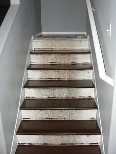 I wonder if this would fix the basement stairs and get rid of the carpet.  How to rip up carpet & redo stairs yourself
