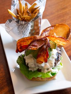This week's featured burger is the Cali-Cobb Burger with Blue Cheese, Bacon, Lettuce, Tomato, Red Onion, and Avocado on a Brioche Roll. Now you can enjoy your side salad right on your burger ;)