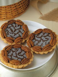 Mini Caramel Pecan Tarts Interesting use of Chocolate Transfer sheets.