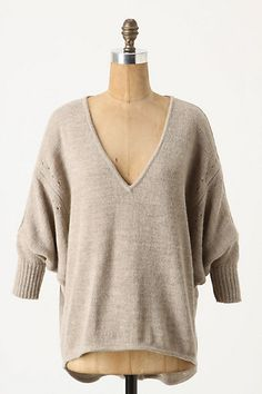 I love the ease of this sweater. The loose sleeves combined with the tapered 3/4 cuff is comfortable/cozy yet chic. Match with your favorite pair of skinnies and cowboy boots....DONE. I'm ready for fall : )