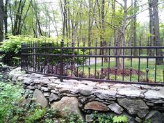 Wrought Iron Fencing on stone walls