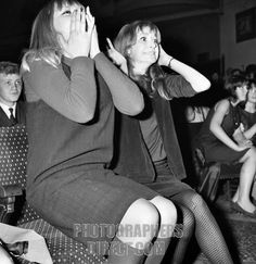 Screaming girl fans greet the Beatles at the ABC Cinema in Wigan . 13 October 1964