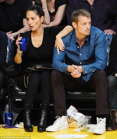 Hands on: Olivia stayed close and kept a hand on Joel during the exciting Lakers vs Sacramento Kings game