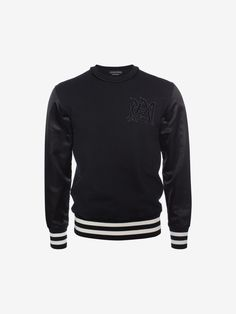 Alexander McQueen ORGANIC EMBROIDERED SIGNATURE SWEATSHIRT 675 EUR / $865. Black organic sweatshirt with contrasting cotton and satin sleeves with striped hem and cuffs. AMQ signature embroidered badge.