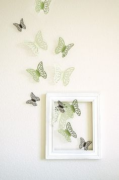 wall decor with butterflies-maybe different frames and different butterflies coming out of those frames