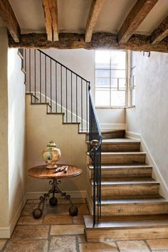 love the look of unfinished wood and wrought iron. (mediterranean staircase by Don Ziebell)
