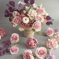 Paper flowers with a romantic and vintage vibe. #dustypink #paperflowers #paperflowerbouquet #handpainted #crepepaperflowers #paperroses