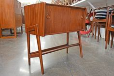 this small danish modern mid century cupboard measures wide x deep x tall this piece features two teak sliding doors which open to two bays one with an