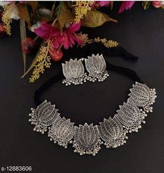 Checkout this latest Jewellery Set Product Name: *German Silver silver lotus choker for women & girls (big)* Base Metal: German Silver Plating: Oxidised Silver Stone Type: No Stone Type: Necklace and Earrings Multipack: 1 Country of Origin: India Easy Returns Available In Case Of Any Issue   Catalog Rating: ★4 (244)  Catalog Name: Diva Fusion Jewellery Sets CatalogID_2503832 C77-SC1093 Code: 691-12883606-993