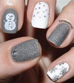 Cute grey and white winter nails. Love the snowman and the snowflakes :)