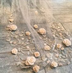 White Satin Roses pinned to an Embroidered Veil