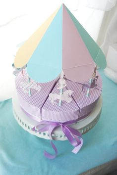 Oooh La La MerryGoRound Favor Box Centerpiece by ooohlalapaperie, $40.00  #merrygoround #carousel #horses #favors #favorboxes #purple #gingham #pastel #birthday #party #ooohlalapaperie #ooohlalapaperieandboutique #oohlalapaperie #ooohlala #oohlala