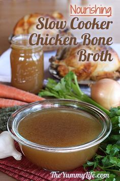 Chicken Bone Broth In A Slow Cooker. Boost your health with this easy, flavorful homemade stock.  TheYummyLife.com