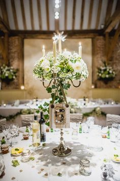 Long candles finished with some beautiful flowers - this centrepiece would go well with my castle venue