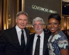 Actor Harrison Ford (left), director/producer George Lucas (center) and Mellody Hobson attend the 2013 Governors Awards at The Ray Dolby Ballroom at Hollywood & Highland Center® in Hollywood, CA, on Saturday, November 16, 2013.