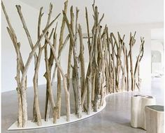 Room divider ..branches! this is inside, but I can see using it next to a patio
