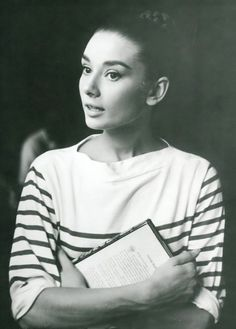 "The actress Audrey Hepburn photographed by Pierluigi Praturlon at the Cinecittà Studios, on Via Tuscolana, in Rome (Italy), during a break in the filming of ""War and Peace"", in August 1955.Audrey was wearing:Blouse: Mark Cross (of a white knitted fabric of cotton with detail of red stripes, of the collection for the Spring/Summer of 1955).The same blouse that Audrey was wearing in this photo…"