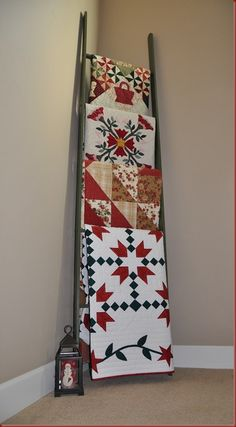 Love the old ladder to display folded quilts, or even large fabric panels waiting to be made into something beautiful.