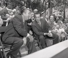 Walt with then Vice-President Nixon and family watching a parade during the inauguration of the Monorail, Matterhorn, and Submarine Voyage expansion of Other members of the Disney family can be seen in the photo.