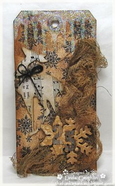 Eye-catchingly creative, aged looking winter tag. #Christmas #winter #vintage #shabby #chic #tag #handmade #crafts #paper #scrapbooking