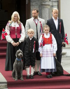 Crown Prince Haakon of Norway and Crown Princess Mette-Marit of Norway with Princess Ingrid Alexandra, Prince Sverre Magnus and Marius Hoiby greet the Childrens Parade on the Skaugum Estate on May 17, 2014 in Oslo, Norway.