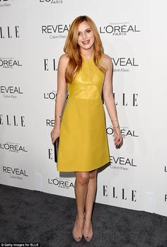 Bella Thorne looked lively in a citrus green mini dress and taupe peep toe heelsat the Elle Women in Hollywood Awards http://dailym.ai/1wlciCw