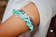 """Aqua Blue Satin & Black/White Paw Print Garter Embellished With White Satin Bow and Rhinestone Paw Print Accent For The Perfect Touch.     *******PLEASE LEAVE YOUR WEDDING DATE AT CHECKOUT*****    ** Garter measures: 1.5"""" W **    * Garter listing is for standard size, if interested in custom size please contact prior to purchasing. *   Shop this product here: http://spreesy.com/BellaDivaCouture/137   Shop all of our products at http://spreesy.com/BellaDivaCouture      Pinterest selling…"""
