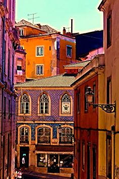 Colourful buildings of Lisbon - Portugal Lisboa Places Around The World, Oh The Places You'll Go, Travel Around The World, Places To Travel, Places To Visit, Around The Worlds, Spain And Portugal, Portugal Travel, Destination Voyage