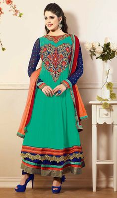 Greenish Blue Shade Georgette Long Anarkali Suit Embrace lovely looks dressed in this greenish blue shade georgette long Anarkali suit. The interesting resham and stones work all through suit is awe-inspiring.  #LongAnarkaliSuit #DesignerChuridarSuits