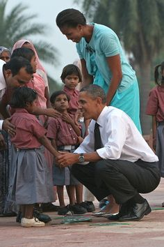 U.S. President Barack Obama and First Lady Michelle Obama talk with the children of workers who carried out renovation works at Humayun's Tomb during their visit in New Delhi.