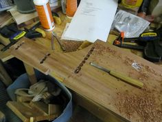 Drilling and chiseling out the for the mortise and tenon joints.