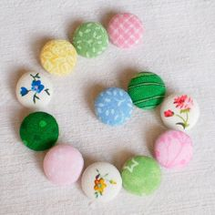 Fabric Buttons - The Spring Is Here - 12 Small Pink, Yellow, Blue and Green Floral Fabric Covered Buttons. $6.80, via Etsy.