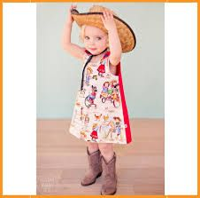 Adorable cowgirl in cowgirl dress!