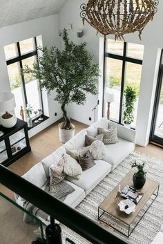 Bright contemporary living room design with neutral white, beige and black decor elements. Neutral living room decor, perfect for staging a home for sale or rental. white living room couch and black window trim in a contemporary design. Home Living Room, Interior Design Living Room, Living Spaces, White Couch Living Room, Neutral Living Rooms, Living Room With Plants, Black And White Living Room Decor, Spacious Living Room, Interior Design Plants