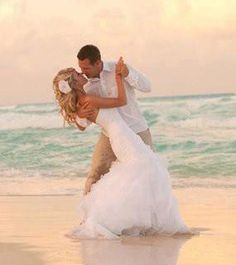 take your wedding dress on your honeymoon so you can  get a pic like this! Such a great pic!
