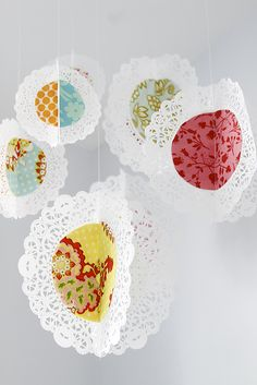 """The hanging fabric doilies were fun to make! I just can't figure out how to hang them from the ceiling. Right now, they're Scotch-taped up there. Really classy. Any ideas?"""