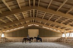 dezeen: Castanheira & Bastai Arquitectos conceived this. Architecture Design, Timber Architecture, Vernacular Architecture, Amazing Architecture, Painel Sandwich, Swimming Pool Architecture, Indoor Arena, Timber Structure, Horse Barns